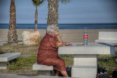 PERO... NO DECIAN QUE TODO IBA MEJOR CON COCA-COLA ¿? (ABUELA PINOCHO ) Tags: españa mujer spain candid banco playa palmeras castellon pensativa sentada robado burriana borriana
