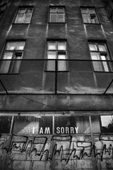 all apologies (james_drury) Tags: street building monochrome architecture concrete grey graffiti blackwhite grim poland warsaw bleak graff dilapidated crumbling iamsorry canonef24105mmf4lisusm