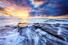 Australia - New South Wales - Turimetta Beach (Jarrod Castaing) Tags: ocean travel blue light sunset sea sky cloud sun seascape motion blur color reflection art tourism beach nature water beautiful beauty rock stone clouds sunrise print landscape outdoors island gold dawn evening bay coast rocks colorful long exposure surf waves view purple natural outdoor dusk background horizon fine scenic peaceful wave australia shore jarrod coastline rays narrabeen castaing turimetta