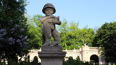 Boy and fish statue - at the entrance to Mrchenbrunnen (Fountain of Fairy Tales) - Volkspark Friedrichshain (luciwest) Tags: park boy sculpture fish berlin nature fountain statue stone skulptur fisch fairy lilac friedrichshain tale prenzlauerberg junge videostill volksparkfriedrichshain flieder maerchenbrunnen inaberlinminute