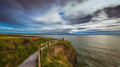 Rough around the Edges (Ray Moloney Photography) Tags: ifttt 500px coast cliffs ocean water rocks seascape clouds blue waves summer ireland fence photographer sky beautiful green light beauty leading lines kerry cliff grass man taking photograph coastline county eire path flowers erosion