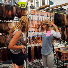 What about this wig? (PaulHoo) Tags: square squareformat albert cuyp market amsterdam holland netherlands 2016 summer nikon d700 candid streetcandid streetlife citylife streetphotography people urban girl woman women wig fun humor shopping