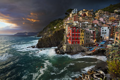 Riomaggiore. (Rudi1976) Tags: riomaggiore cinqueterre traveldestinations italy thunderstorm weather laspezia town mediterraneancountries liguria coastline mediterraneansea cityscape sunset famousplace harbor europe village dusk watersedge architecture rockycoastline highangleview travel tourism liguriansea fishingvillage twilight colorimage locallandmark nationallandmark outdoors horizontal dramaticsky unesco