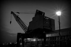 Mechanical Dinosaur (Gareth Priest) Tags: city uk longexposure light urban bw inspiration building art history wales night docks dark landscape nikon streetlight experimental industrial angle crane creative cardiff cardiffbay starry d5100