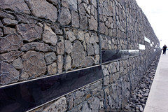 Fossil entrance wall (sbyrnedotcom) Tags: stone wall architecture buildings grey wire entrance australia arboretum canberra act fossils gabion