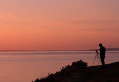 The Photographer (jillyspoon) Tags: light sunset silhouette canon photographer horizon tripod patience irishsea machars canon60d