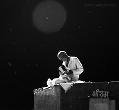 Pray (Saptashaw Chakraborty) Tags: blackandwhite bw india canon streetlight sigma holy lensflare flare varanasi ram benaras ghat shriram uttarpradesh 50d eos50d 1770oshsmmacro