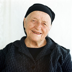 Portrait of a senior woman (Nasos Zovoilis) Tags: life old travel pink grandma portrait people woman brown white color senior beauty face look proud lady female rural scarf hair greek happy person clothing women europe mediterranean european village looking dress adult grandmother folk expression background character postcard teeth traditional country gray mother mani pride greece human mature elderly age experience elder laugh older aged redneck balkans wisdom tradition middle granny joyful widow retired suffering aging tough wrinkles wrinkle isolated textured peasant villager caucasian