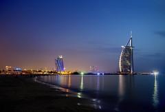 Burj Al Arab -  Jumeirah Beach - Dubai, United Arab Emirates (Greg - AdventuresofaGoodMan.com) Tags: sunset reflection water architecture hotel neon dubai glow burjalarab bluehour unitedarabemirates jumeirah jumeirahbeachhotel unitedarabemerates worldslargesthotel
