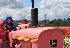 (Julia TortoiseHugger) Tags: tractor kids oregon vintage candid or johndeere pinktractor woodenshoetulipfarmwoodburn