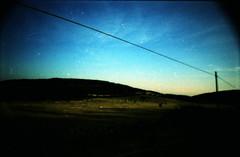 (pi adatti ai mutamenti.) (piermario) Tags: sardegna light shadow sky lomo xpro sardinia fuji ombra things days wires cielo land terra provia luce heima csi giorni cose cavi gallura inviaggio lasardina