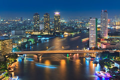 Bangkok Night (Noom HH) Tags: city bridge blue building tower night river thailand boat twilight cityscape nightscape bangkok bluesky hour thai nightlight chaophrayariver
