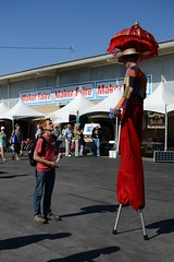 Excuse me sir, I'm looking for Oz... (fasaxc) Tags: red man walker tall stilts stilt makerfaire2013