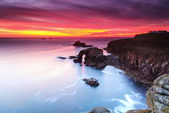 Afterglow (Martin Mattocks (mjm383)) Tags: ocean sunset red sky orange seascape reflection water clouds landscapes rocks cornwall glow arch horizon landsend coastline afterglow longexpsoure singhray leefilters canoneos5dmarkii distagon2128ze mjm383 martinmattocksphotography