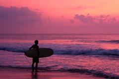 Surfing at sunrise. (instant_Focus) Tags: sunrise surf beach ocean fujifilm fujifeed