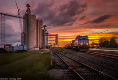 Norfolk Southern 4001 Sunset (Brandon Townley) Tags: trains railroad ns norfolksouthern 4001 waterloo indiana sunset switcher grainelevator