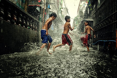 Monsoon rain and flood (Mio Cade) Tags: rain flood manila tondo philippines street children kid boy play shower bath swim travel reportage documentary