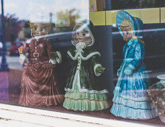 Watching (Lee Edwin Coursey) Tags: georgia statue storefront dolls reflection shop rural creepy 2016 exploring town lawrenceville