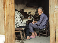 old woman doorway copy (anwoody) Tags: approved xingping china guano people streetlife