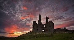 Remains of the day (Captain Nikon) Tags: sunset dusk panoramic stitched moody ruins dunstanburghcastle northumberland northeast coastal nikond7000 haunting remains historical