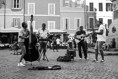 Street Musicians Combo Campo de Fiori Rome (futurepics) Tags: rome italy 30mm eos 50d canon campodefiori bw monocrome streetmusicians people street streetphotography streetlife blackwhitephotos 100v10f bass black blowing city day europe european guitar horn instrument jazz male man music musician outdoor outside performance performer play player playing sax saxophone song sound urban white young artist artists piazza