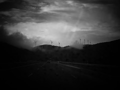 a trip (lord_yomismo) Tags: mill car rain clouds lluvia highway carretera wind cloudy viento coche molinos energa elica