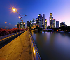 Crossways (night86mare) Tags: city blue light shadow panorama reflection skyline river way drive twilight singapore warm glow cityscape pano lamppost esplanade hdr k5 shenton 10mm