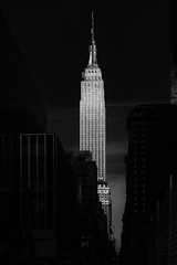 The Empire State Building, New York (Sunset Noir) Tags: world street camera new york city nyc light urban bw white ny newyork black building tower art texture architecture work lights photo blackwhite high twilight nikon flickr downtown view state metro center icon empire gotham  blvd yorker the    blackwhiteaward