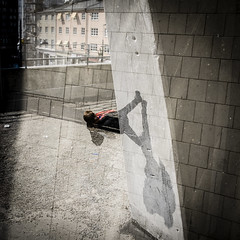 Hard Way Home (petertandlund) Tags: street people urban woman color wall sweden stockholm doubleexposure streetphotography defyinggravity multiexposure flickrfriday peopleinmotion xe1 fujix