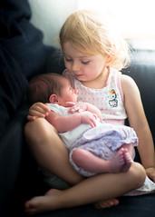 Sisters (Mike Brnnimann) Tags: baby girl sisters young kids children bokeh nikkor 85mm nikon d800 light sun warm