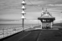 Relaxing On The Prom (nigelhunter) Tags: relaxing prom promenade shelter coast landscape sky man street candid lamp urban fence shore blackpool lancashire