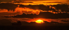 Sun Setting (Luis-Gaspar) Tags: portugal carcavelos landscape seascape paisagem paisagemmaritima sunset sunsetlight sunlight luz luzsolar clouds nuvens orange laranja water agua boat barco nikon d60 55300 f16 1125 iso100