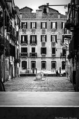 Venice Streetlife ... (alessandrafinocchiaro67) Tags: monochrome manual black white street streetlight well venice venezia nikond3100 chair balcony flowers pavement windows bridge