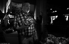 Crab for tea. (Neil. Moralee) Tags: french france market crab fisk monger sale shopping people man old mature beard dark dim black white bw blackandwhitr mono monochrome nikon d7100 candid street sea food buy buying neil moralee 18300mm