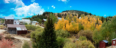 Fall At Sliver City (http://fineartamerica.com/profiles/robert-bales.ht) Tags: forupload haybales idaho people photo places projects slivercithy states ghost town old abandoned historic antiquewood west wooden building vintage western mountain tourism usa buildings rustic transport mine gold pioneer architecture landscape houses goldmine miners sand national clouds mineral woodbuidling weathered goldtown street cowboy forgotten robertbales sliver owyhee mountains silvercity empirecity rubycity mines nature colorful autumn alpine fall panorama