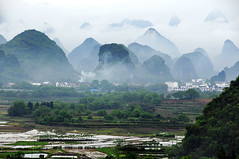 Limestone hills & village (Mel s away..) Tags: oolong idyllic scenery   guangxi china   field farm pattern hill limestone chanmelmel melinda rural countryside panorama layers yangshuo village paintnglike fog mist nature
