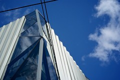 Glass, metal & blue sky (Caropaulus) Tags: blue sky cloud weather architecture day clear bleu ciel departmentstore alsace nuage printemps grandmagasin facade tempsclair