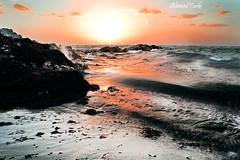 Winter Sunset (Ahmed Turki) Tags: winter light sunset sea sky sun seascape seaweed beach water sunrise canon landscape eos rebel bahrain rocks wintersunset details natur sparkle stunning sparkling t3i sparklingwater topshots mywinners theunforgettablepictures efs1855mmis canon600d ahmedturki 890904162