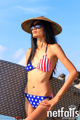 Beautiful woman on the beach. (Netfalls) Tags: ocean travel blue sea summer vacation sky woman hot cute sexy beach nature water girl beauty hat female relax thailand island happy person one coast healthy paradise surf waves natural pacific legs body space flag board sunny bamboo sensual exotic health bikini american attractive tropical coastline relaxation bliss freshness blissful