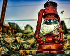 I Ran Out Of Oil (hbmike2000) Tags: light sun glass lamp metal nikon rocks bokeh naturallight rusted d200 hdr gettyimages oillamp explored thesunwillcomeouttomorrow niksoftware ourdailychallenge hbmike2000 bigballofgas worstsongintheworld getthatoneoutofyourhead michaellkaser