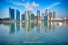 Singapore City Skyline 01 - HDR (yewkwangphoto) Tags: sea cloud seascape tourism water horizontal architecture landscape singapore asia cityscape bluesky tourist hotels hdr banks skyscaper famouslandmark commercialbuilding placeofinterest modernbuildings modernstructure buildingstructure singaporecityskyline photocategory yewkwang photographybyyewkwang