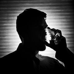 Anonymous Drinker (CarbonNYC [in SF!]) Tags: idontdrinkforwhatitsworth self selfportrait portrait alcoholic alcoholism silhouette man drinking drink bw somber dark gloomy carbonnyc carbonsf