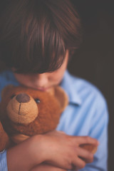 Comforted by you (Adriana Varela Photography) Tags: life bear boy childhood toy stuffed hug quiet child sad teddy emotion lookingdown emotions upset protect