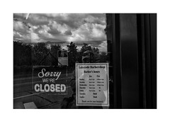 Sorry We're Closed (Richard C. Johnson: AKA fishwrapcomix) Tags: fujixpro1 18mm paxamericanus endofempire bw shopwindow blackwhite blackandwhite monochrome barber barbershop reflections clouds signswonders civisromanussum thegreatrecession economicdownturn sunsetsinthewest sunrisesintheeast duluth minnesota midwest text