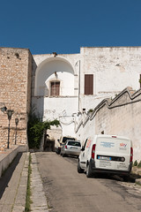 IMG_7745 (jaglazier) Tags: 13thcentury 13thcenturyad 15thcentury 15thcenturyad 16thcentury 16thcenturyad 17thcentury 17thcenturyad 2016 8216 apulia arches architecture august buildings castles centrostorico cittabianca copyright2016jamesaglazier fortresses forts gates hilltowns houses italy newgate oldtown ostuni portanuova ramps spanish towers urbanism walls whitecity circuitwalls cities roundtowers streets streetscapes whitewash whitewashed puglia
