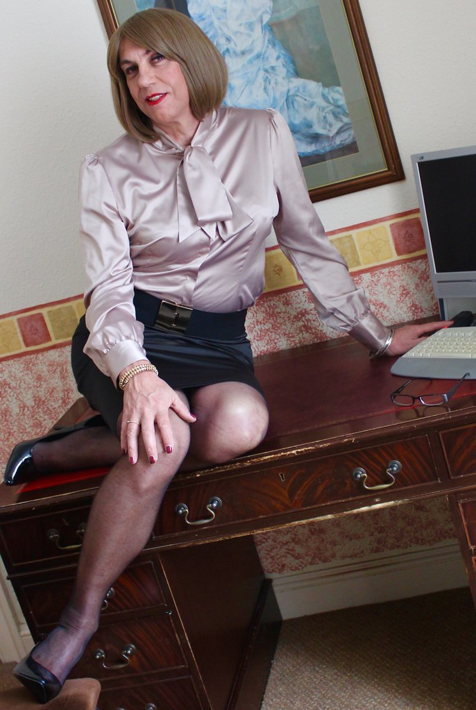 Transvestite in satin blouse