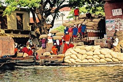 The Rice Market (The Spirit of the World) Tags: market marketplace workers locals rice bagsofrice waterway backwaters kerala india southernindia commerce commodity