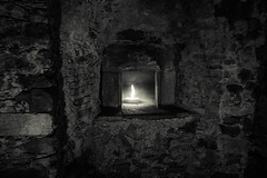 A light in the dark (elisabartolini) Tags: light lightinthedark candle candlelight cell architecture oldprison stonewalls streetphotography shadows lucca love darkness blackandwhite fadinglight bnw blackwhitephotography blackandwhiteworld blackandwhitephotography bw bnwlovers biancoenero amateurphotography atmosphere abandonedplace canon canonphotography photography wanderlust exploring beautifulplaces structure lovesblackandwhite
