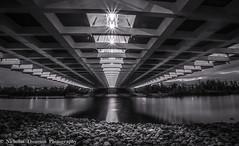 Mankind (Light1Scene) Tags: ottawa ontario bridge water rocks structure night blackandwhite canada reflection river rideauriver canon sigma spacetruss archbridge