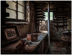 A room full of memories (Hugh Stanton) Tags: photoframe workbench box post window shelves planks tools abandoned appickoftheweek